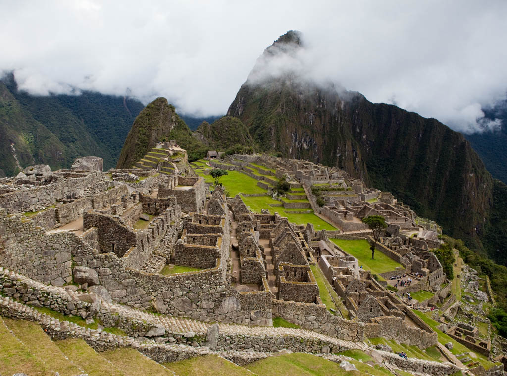 View over the ruins of Machu Picchu with Huayna Picchu mountain in the background