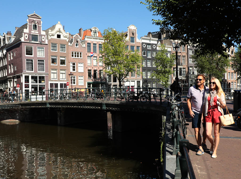 Couple in Amsterdam next to river