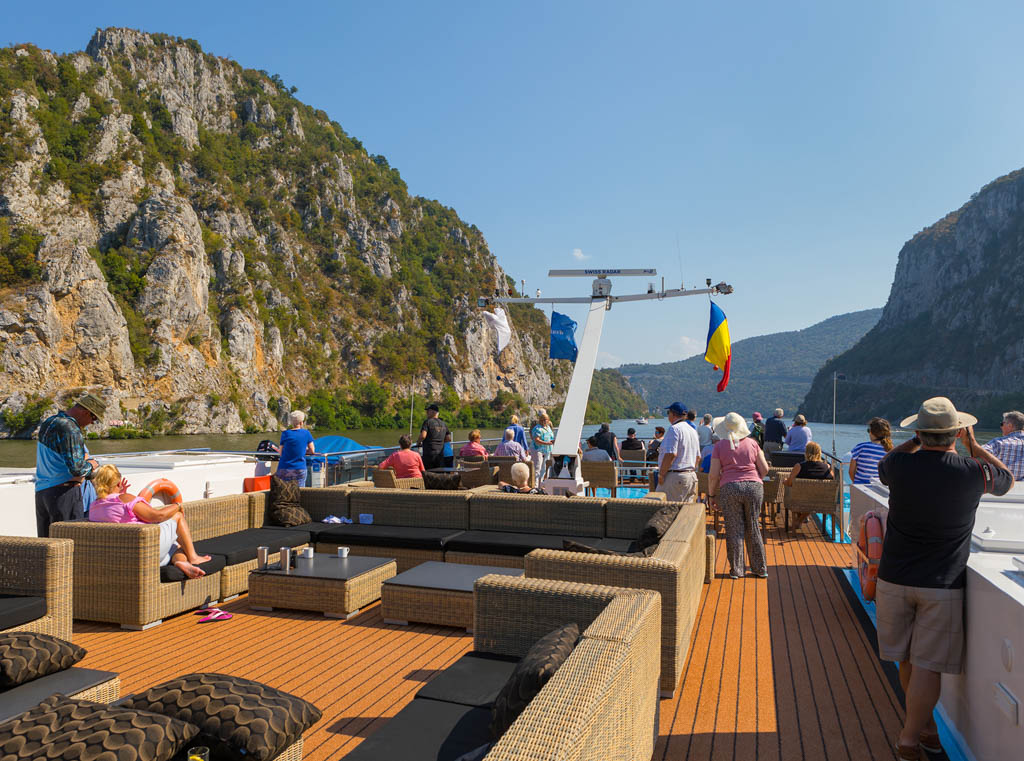 Group of travellers on deck of river cruise ship