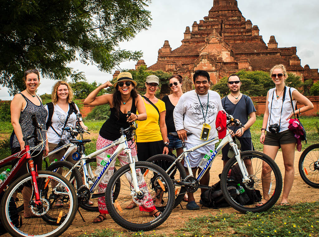 Cyclists in Myanmar in front of temple in Bagan