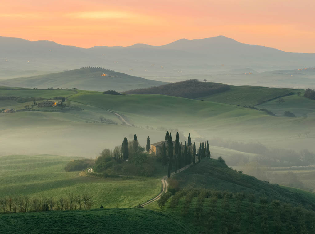 Rolling hills of Tuscany with morning mist