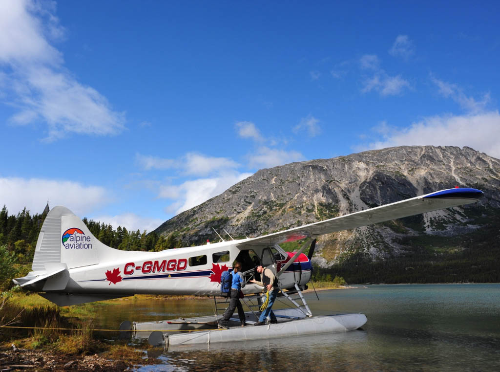 Float plane in the Yukon with hill in background