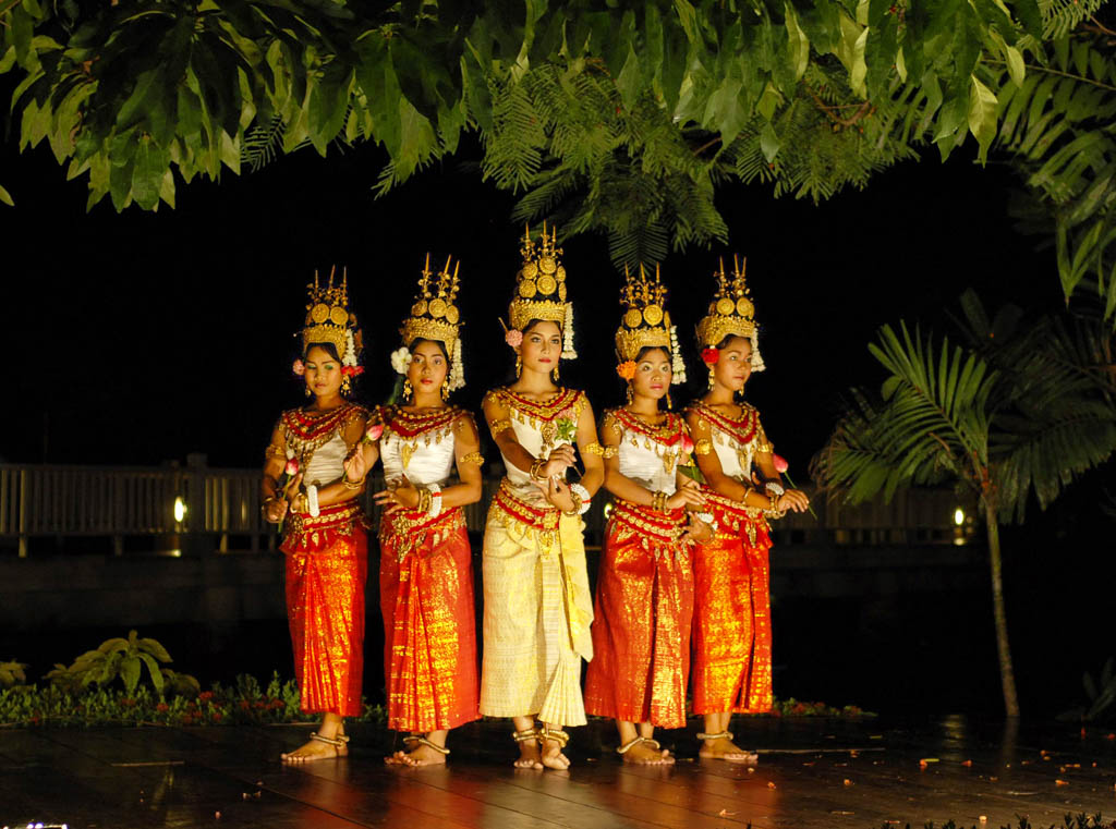 Five women in traditional dress do ceremonial dance in Cambodia