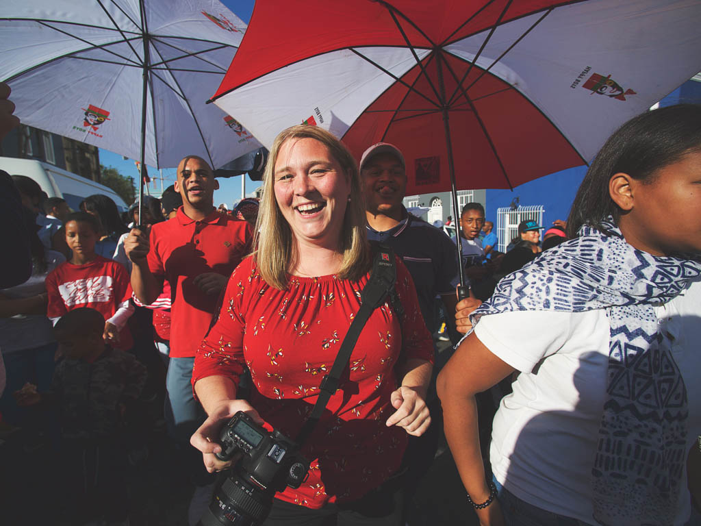 Shari Tucker smiling at gathering in South Africa surrounded by many other spectators