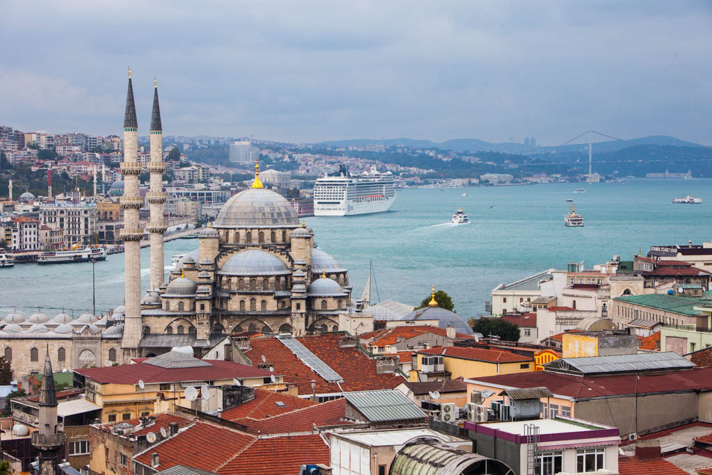 Cityscape of Istanbul in Turkey with mosque in foreground and cruise ship in background