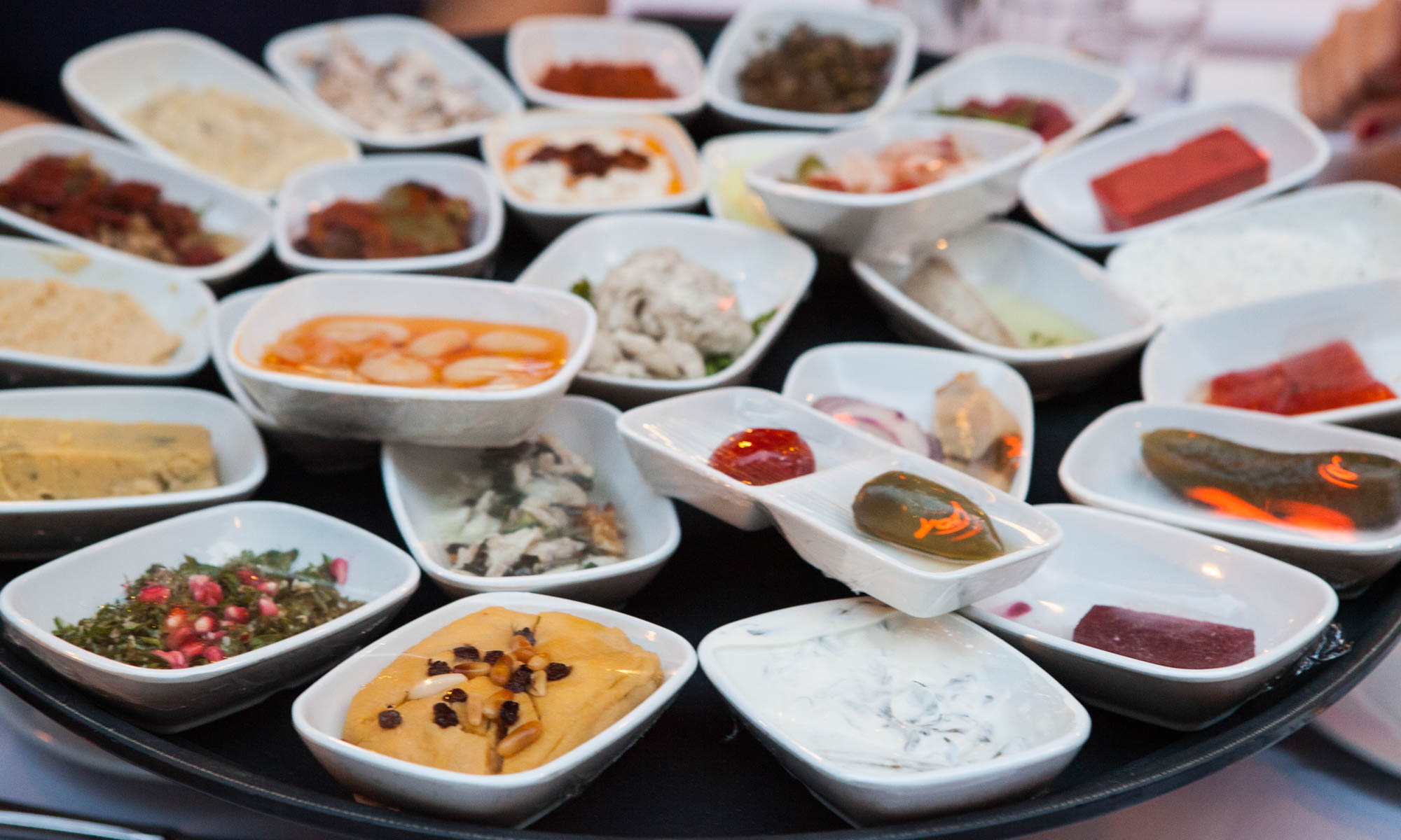 Spread of small plates of Turkish meze
