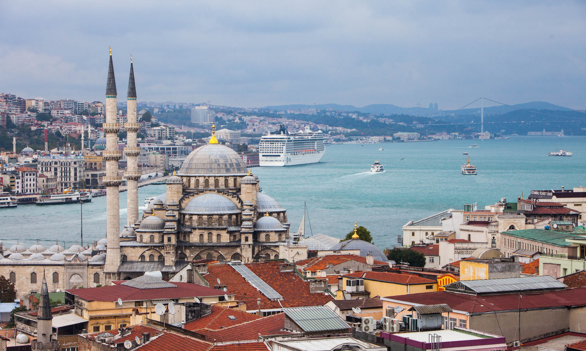 View of mosque in Istanbul with a cruise ship in the background