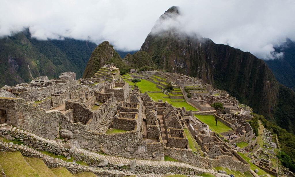 The ruins of Machu Picchu in the fog