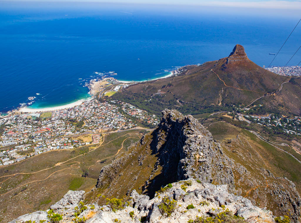 View from Table Mountain of Lion's Head mountain, the blue ocean, city and breach below