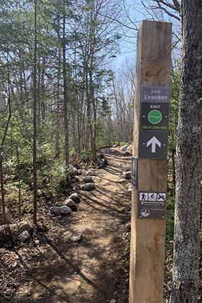 Sign post for Joe Cracker trail a mountain bike trail through the woods in Spryfield, Nova Scotia