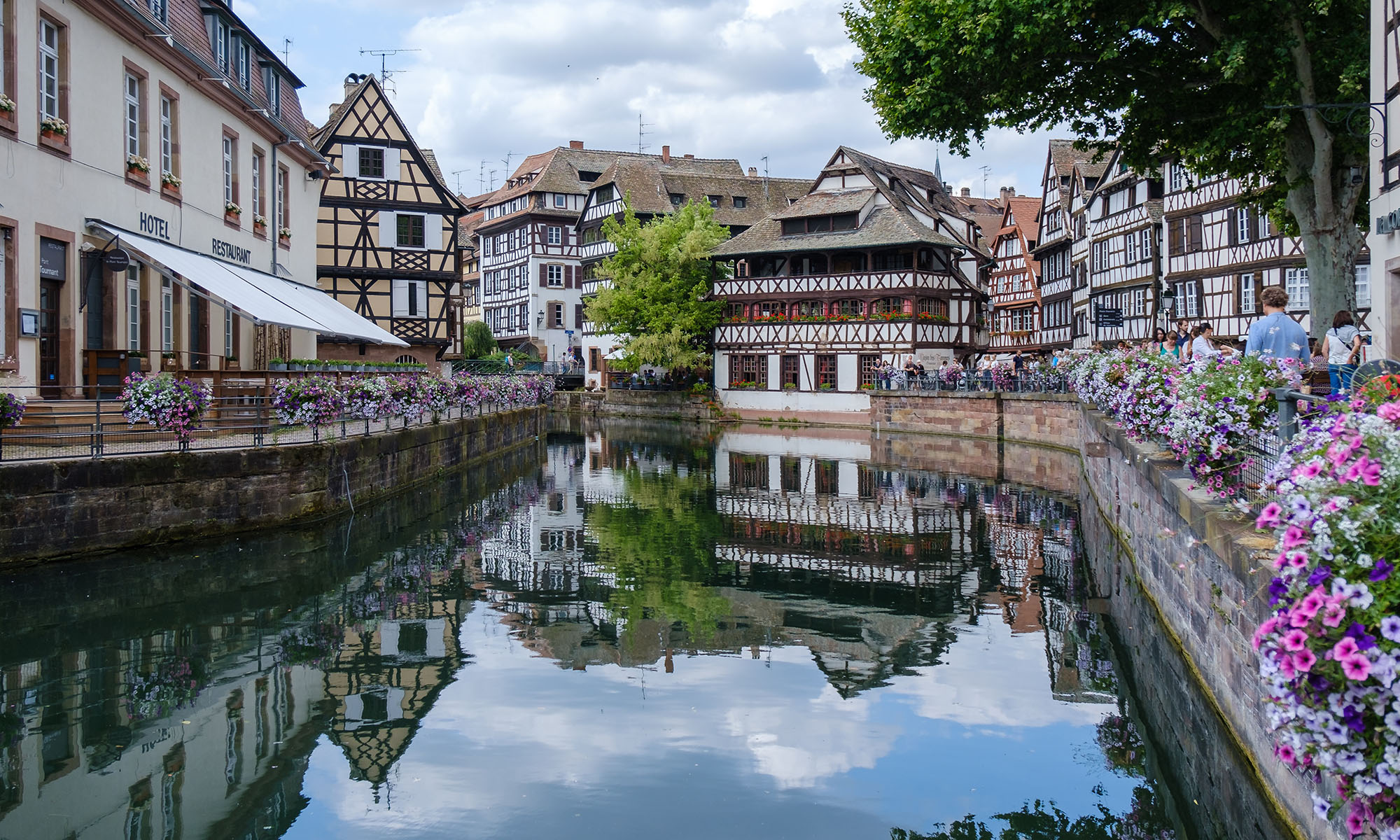 Historic buildings along a river in Strasbourg, France