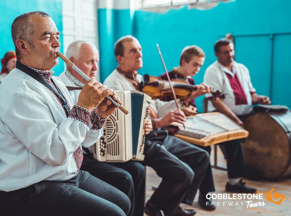five men playing traditional Ukrainian instruments